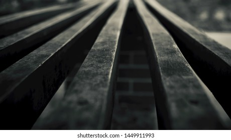 Wooden straight lines isolated black and white blurry photo