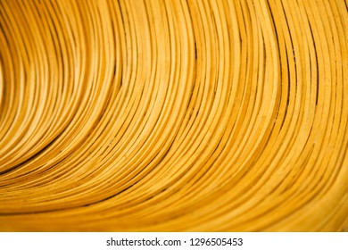 Wooden strings in tuble-like curve, abstract background image.