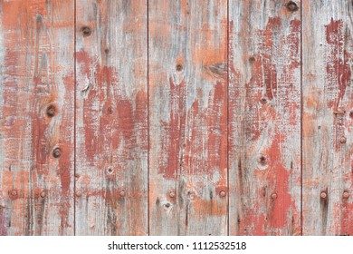 Wooden structure with fragments of paint as background