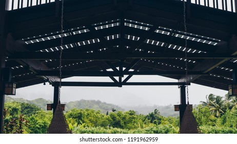 Wooden structure overlooking the cloudy mountains in Hanalei Bay, Kauai