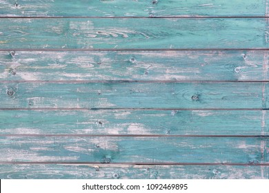 Wooden structure with paint fragments as background