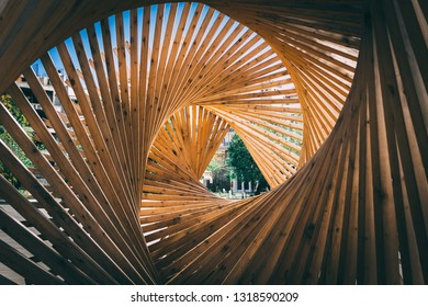 Wooden structure in triangle tunnel shape. Modern. Nobody. A look through long tunnel design. Perspective.