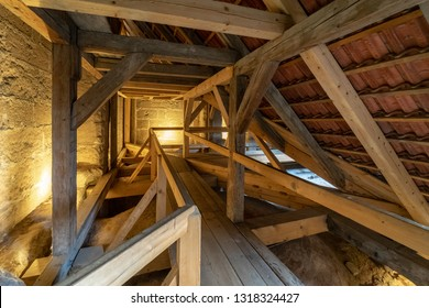Wooden structures (rafters and beams) of the attic of an old house.