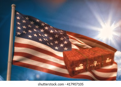 Wooden suitcase against united states of america national flag on flagpole