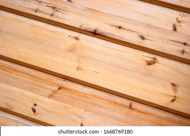 Wooden surface planks wall texture. Close up brown wood.