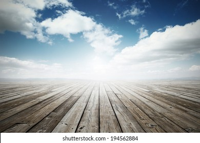 wooden surface under blue sky