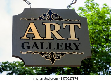 Wooden suspended art gallary sign.