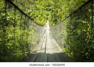 Wooden suspension bridge over river in Panajachel, Guatemala, Central America