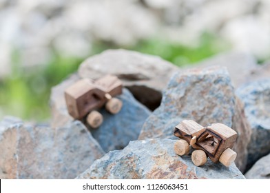 Wooden SUV, toy car in an extreme landscape./SUV toy car in nature