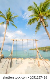 Wooden swing and coconut palm tree over summer beach sea in Ko Kut or Koh Kood, Trat Province,Thailand. Summer, Travel, Vacation and Holiday concept