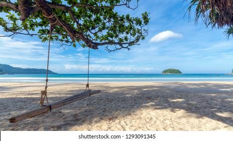 Wooden swing at Kata Beach, Phuket, Thailand on a beautiful day