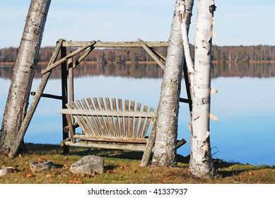 a wooden swing on a clear lake on a calm day