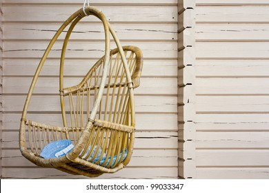 Wooden swing on the porch