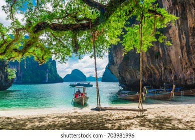 Wooden swing under tree on the beach, Scenery of beautiful destination island, Koh Lao Lading island, Andaman sea, Krabi, Travel in Thailand, Summer and vacation concept