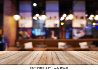 wooden table with abstract blurred background resturant lights used for display montage products mock up design.