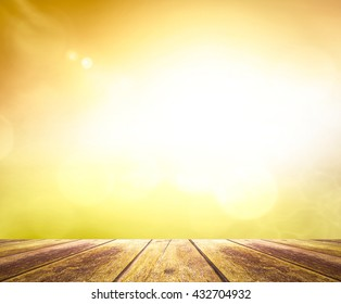 Wooden table with abstract blurred beautiful yellow nature background