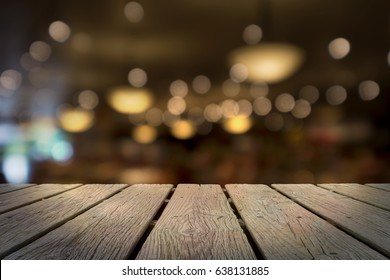 WOODEN TABLE WITH BACKGROUND OF BLURRED AND BOKEH OF LIGHTS AND CHANDELIERS IN LUXURY SUSHI BAR, JAPAN (FOR ADD TEXT, MESSAGE, MERCHANDISES)