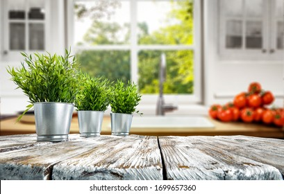 wooden table background of free space and blurred home interior with window