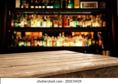 wooden table and bar space
