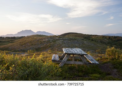 Wooden table with benches at hiking trail in Helgeland, North-Norway.