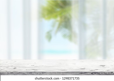 Wooden table and blue seascape on a background. Beauty nature background
