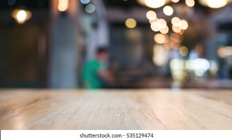 Wooden table in blur cafe background