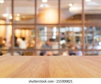 Wooden table and blur restaurant background