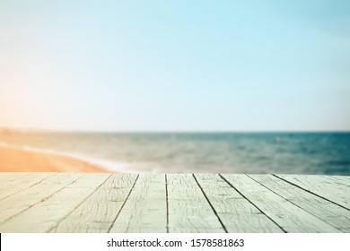 Wooden table blurred background  sea shore Concept of a summer holiday Place is empty for your text or scenery