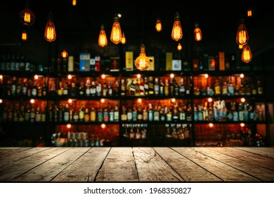 Wooden table with Blurred liquor bar background