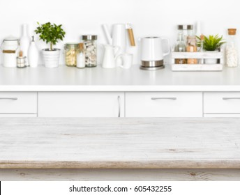 Wooden table with bokeh image of different kitchen common products