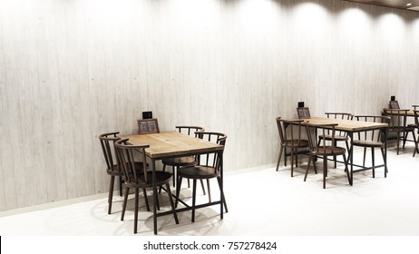 Wooden table and chair in the restaurant . Interior of restaurant food and beverage cafe with wooden table and chairs, food menu on the table and vintage wooden background.