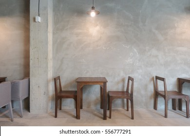 Wooden table and chair in the restaurant with pendant light