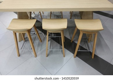 Wooden table and wooden chair Set on modern tile floors