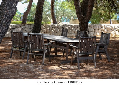 Wooden table and chair stand in the garden