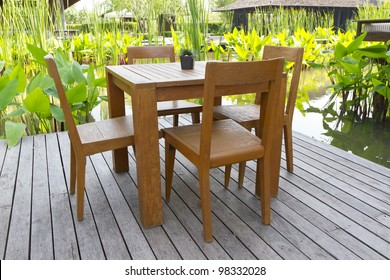 wooden table chairs in garden