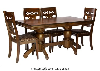 Wooden table and chairs isolated on white background