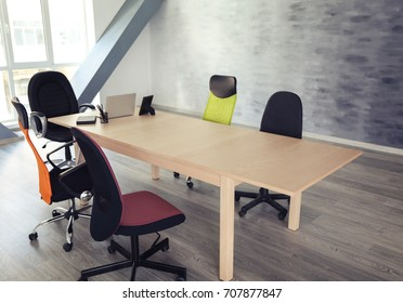Wooden table with chairs in office