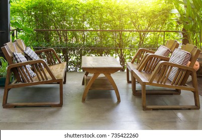Wooden table and chairs outdoor furniture in the garden for relaxation