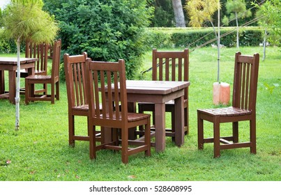 wooden table and chairs outdoors
