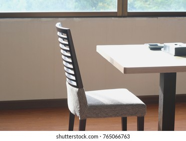 Wooden table and chairs in sunlight morning