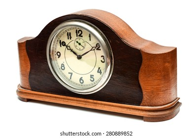 Wooden table clock on a white background