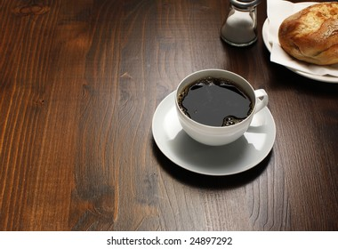 Wooden table with coffee and breakfast
