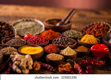 Wooden table of colorful spices - Shutterstock ID 225001330