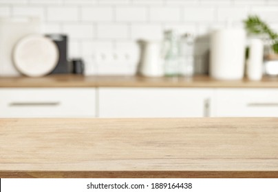 wooden table and defocused kitchen interior background