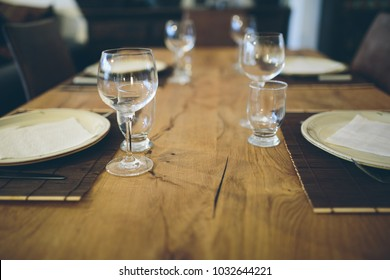 Wooden table with dining set.