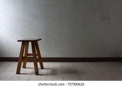 A wooden table in an empty room
