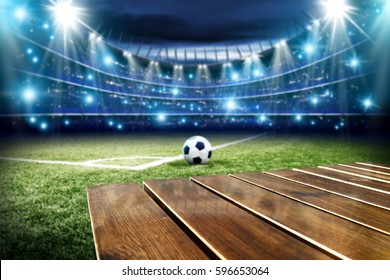 wooden table and football pitch