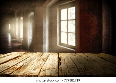 Wooden table of free space and background of few windows