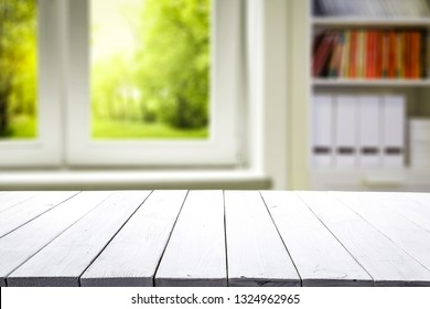 Wooden table of free space and big spring window and wall of white color.
