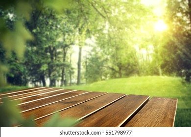 wooden table of free space in garden and spring time